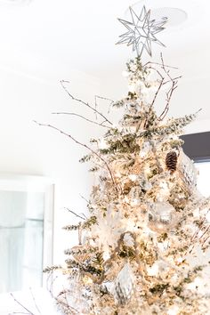 Seasonal Simplicity Christmas Living Room   blesserhouse.com - A tour of a neutral Christmas living room with simple, natural decor, mercury glass, and a modern rustic vibe. #christmaslivingroom #neutralchristmas #christmasdecor