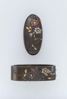Fuchi-kashira with designs of flowering branches. Japanese Edo period early to mid-19th century http://www.mfa.org/collections/object/fuchi-kashira-with-designs-of-flowering-branches-12602