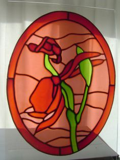 A hand painted stained glass effect window painting / window cling / sun catcher.