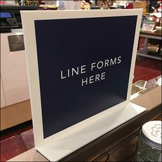 Though also capable of table- or counter-top use, this Checkout Line-Forms-Here Magnetic Sign is employed in just that final manner, atop the Median of Table Signs, Craft Fairs, Letter Board, Close Up, Line, Signage, Magnets, Retail, Washroom Sign