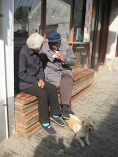 sweet older couple w/ their pet