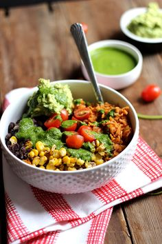This vegan burrito bowl is chock full of flavor with spanish rice, seasoned black beans, and veggies plus a drizzle of chimichurri - it is sure to please!