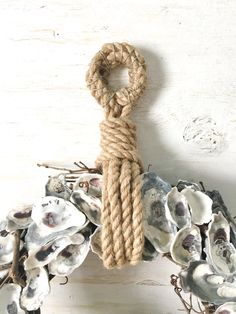 18 Oyster Shell Wreath, Oyster Wreath, Oyster Decor, Nautical Wreath, Beach Wreath Coastal Wreath, Beach Decor, Coastal Decor, Rope Wreath ______________________________________________________ This oyster shell wreath is great for those that dont care for bows and frilly stuff on