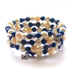 Inspiration only.  Blue and Ivory Glass Pearl Memory Wire Bracelet