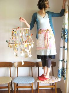 I have been looking for a frame idea to create the turquoise bead chandelier, this could work!  Faux chandelier made from lampshade innards