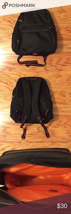 """Solo Laptop Backpack Holds 17"""" Laptop Computer Black with Orange trim and Orange interior; padded compartments protect laptops up to 17"""". Side pockets with two front pockets. Barely used; looks brand new Solo Bags Backpacks"""