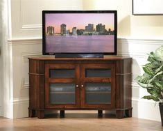 Amish Arlington Corner TV Stand Fit the gorgeous Arlington in the corner and settle in for an evening of television. Offers storage and fine Amish craftsmanship. Built in choice of wood and stain.