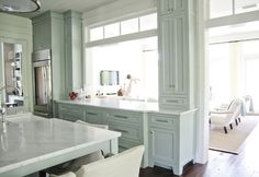 I want this style of opening in my kitchen! One without upper cabinets forcing me to cran my neck to look under them and into the den.