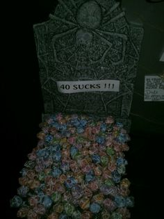 My 40 sucks tombstone with dum dum suckers