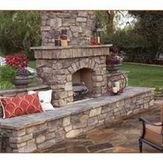 Awesome outdoor fireplace, love the hearth seating!