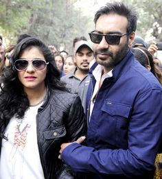 Ajay Devgn escorts Kajol to the venue at a breast cancer awareness event in Pune.