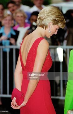 Diana, Princess of Wales attends a fund raising gala dinner for the American Red Cross in Washington, Diana is wearing a dress designed by Jacques Azagury