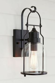Taylor Indoor/Outdoor Sconce at Pottery Barn. Love this light. Would go with any decor. #ad