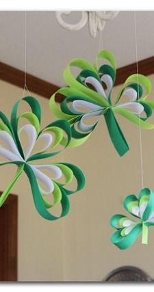Shamrocks made out of paper - there's a tutorial on how to make them - so easy - -Paper Strip Shamrocks ~ Sugar Bee Crafts