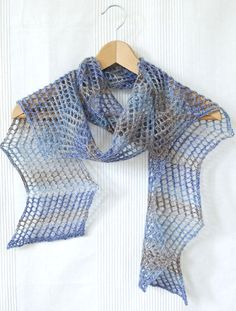 Free Knitting Pattern for Easy 2 Row Repeat Aegean Scarf - Zigzag mesh scarf with alternating 2 row repeat patterns for right leaning and left leaning to create the zigzag. Fingering weight yarn, Designed by Skeinwalker for Knotions. Rated very easy by Ravelrers. Great with multi-colored yarn.