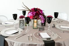 pink, purple, black flowers and feathers #wedding this is how you do mirrors