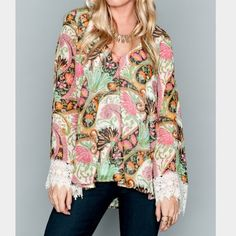 New show me your mumu mal top palace paisley med New with tags show me your mumu mal top in palace paisley print. Size is medium. I love this top but the sleeves are too long on me. Very pretty lace on cuffs and the top is lined so it's not see through. Price is a little flexible (and always less on M e r C) if you want to make an offer use the button please. Smoke free home. Show Me Your MuMu Tops Blouses