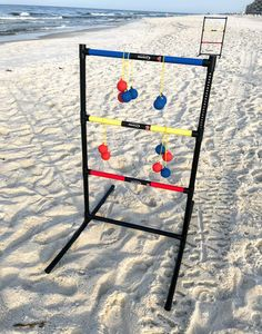 Beach games for kids, teens, adults and families include this lightweight and portable ladder toss game.  #beachgames #beachtipsforkids #beachfun