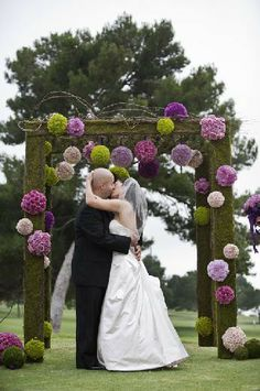 My favorite wedding arch idea. Only use DIY pom poms out of fabric or tissue paper for the flower balls. by sunshinesis