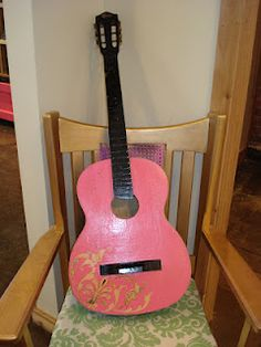 I handpainted this old guitar for a boutique. She hung it on the wall for decoration!