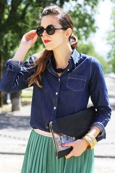 outfit with a long green skirt and round sunnies