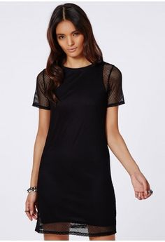 This fierce fishnet fabric t-shirt dress is what we are obsessing over here at Missguided. With a simple black under cami and striking fishnet style overlay, contrasting black ribbed collar and short sleeves this dress is mega edgy. Team th...