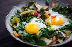 Eggs, steamed on a bed of sauteed chopped chard, onions, and shiitake mushrooms.  I'm sure this would be good with kale as well and maybe a couple of slices of bacon cut into lardons.