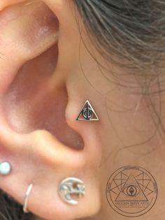 Cody got to end his Friday night with this fun tragus piercing. Ally is a big Harry Potter fan, so this white gold Deathly Hallows from BVLA was the perfect piece of jewelry. Thanks so much Ally! @vaughnbodyarts​ Monterey, CA