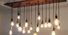 Pendant Lighting Edison Mixed Bulbs hanging from Timber Panel #Rustic #Industrial #Lighting