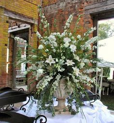 Large Arrangement Featuring White Roses, White Gladiolus, White Lilies, White Dendrobium Orchids