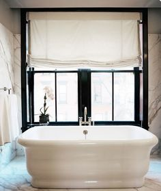 Can you say, tub lounging surrounded by marble divine?