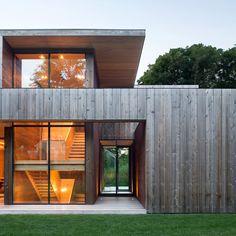 dark window frames with light cedar