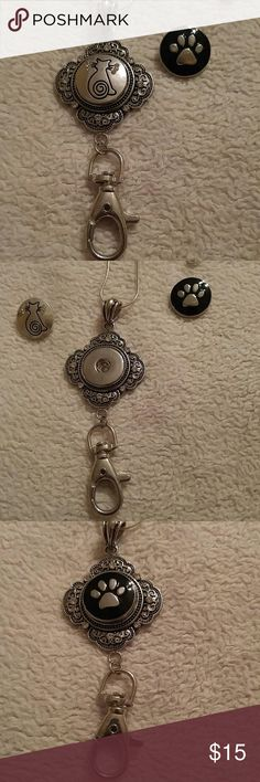 """Snap Silver Lanyard w/2 Cat/Paw Print Badge Clip Snap Silver Lanyard w/2 18mm snaps. One Cat and one Paw Print. Not retractable. Comes on 26"""" .925 snake chain. New. No tags. Jewelry Necklaces"""