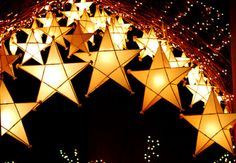 Oh my stars! ornaments hung from an outdoor shelter