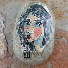 Face Rock 1: original painted lady face on smooth stone, gouache, ink, face on rock, decoupage, one of a kind, paperweight. $20.00, via Etsy.