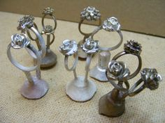 Silver and bronze castings made using Microfoundry. These rose rings where taken from waxes cast in sugar craft molds provided for use in cake decoration.