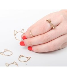 Delicate cat rings that will look lovely next to your wedding band.