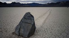 """In the dry lakebed of Racetrack, Death Valley stones as big as 700 pounds mysteriously slide across the surface of the earth without any notable external forces acting upon them. While some researchers believe a combination of natural events, such as wind and ice, cause these stones to """"sail"""", others question this theory pointing out that the stones don't follow a predictable path and change directions abruptly."""