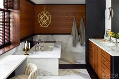 Love the wood & marble wall in this luxury bathroom