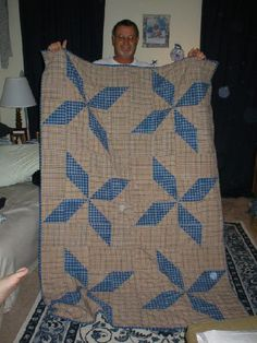 Dad holding up the giant pinwheels quilt I made for my grandfather when he was diagnosed with esophageal cancer