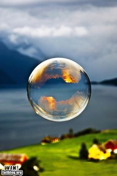 Great shot of the sunset reflecting in a bubble.