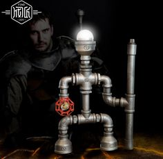 94.49$  Buy now - http://alifeo.worldwells.pw/go.php?t=32684541074 - Knight Robot Iron Water Pipe Loft Industrail Desk Lamp Personality Creative Table Lamp For Home Room Bar Light Luminaria De Mesa 94.49$