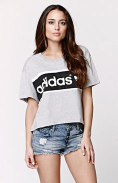 """The women'sCity Tee by Adidas for PacSun and PacSun.com offers a crew neckline and graphic on the front. We love the oversized fit and slightly cropped cut. Wear this t-shirt with our high waisted denim and sneakers!   22"""" length 6.5"""" sleeve length Measured from a size small Model is 5'9"""" and wearing a small Machine washable Made in USA"""