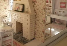 """Cynthia's made this lovely miniature house from a kit called the Orchid by Greenleaf dollhouses.    In Cynthia's words  """"In my mind, th..."""