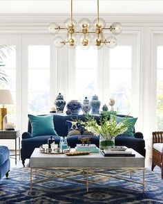 of our most eye-catching chandeliers features 16 oversized globe bulbs! One of our most eye-catching chandeliers features 16 oversized globe bulbs!,One of our most eye-catching chandeliers features 16 oversized globe bulbs! Living Room Interior, Home Living Room, Living Room Furniture, Living Room Decor, Dining Room, Living Room Blue, Blue Velvet Sofa Living Room, Chandelier In Living Room, Interior Livingroom