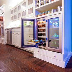 Create a Beverage Center | True makes undercounter refrigerators that are just 15 inches wide, so its easy to find a spot for them in almost any kitchen. We combined a refrigerator with a wine fridge to create a complete drinks station.