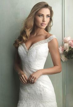 Brides: Allure Bridals. This lace gown features contoured off-the-shoulder straps edged with beads and Swarovski crystals.See Allure Bridals on YouTube
