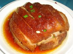 Dongpo Pork is a Hangzhou dish which is made by pan-frying and then red cooking pork belly.The dish is named after revered Song Dynasty poet, artist and calligrapher Su Dongpo, who is supposed to have invented, or at least inspired it. |China photo