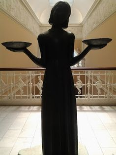 """Today the """"Bird Girl"""" statue may be found in the main hall of the Telfair Academy on a 5th floor balcony and walkway. The location is so remote, in fact, that many visitors pass through without seeing this famous piece at all…"""