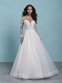 Regal and elegant, this show-stopping ballgown features beaded illusion detailing and a horsehair hemline for added structure. Beautiful illusion sleeves and illusion back. Wedding Dress Boutiques, Wedding Dress Shopping, Bridal Wedding Dresses, Bridesmaid Dresses, Tulle Wedding, Bridesmaids, Lillian West, Bridal Show, Bridal Style